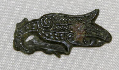 A close up of an Anglo-Saxon decorated copper object from bamburgh bowl hole.
