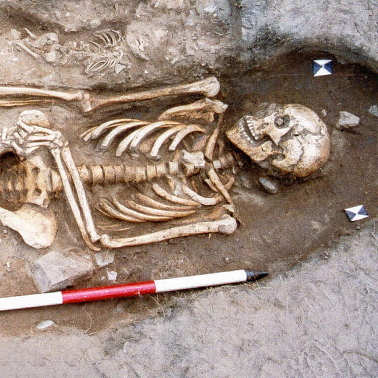 A skeleton with codename Frymð as discovered in the bowl hole graveyard
