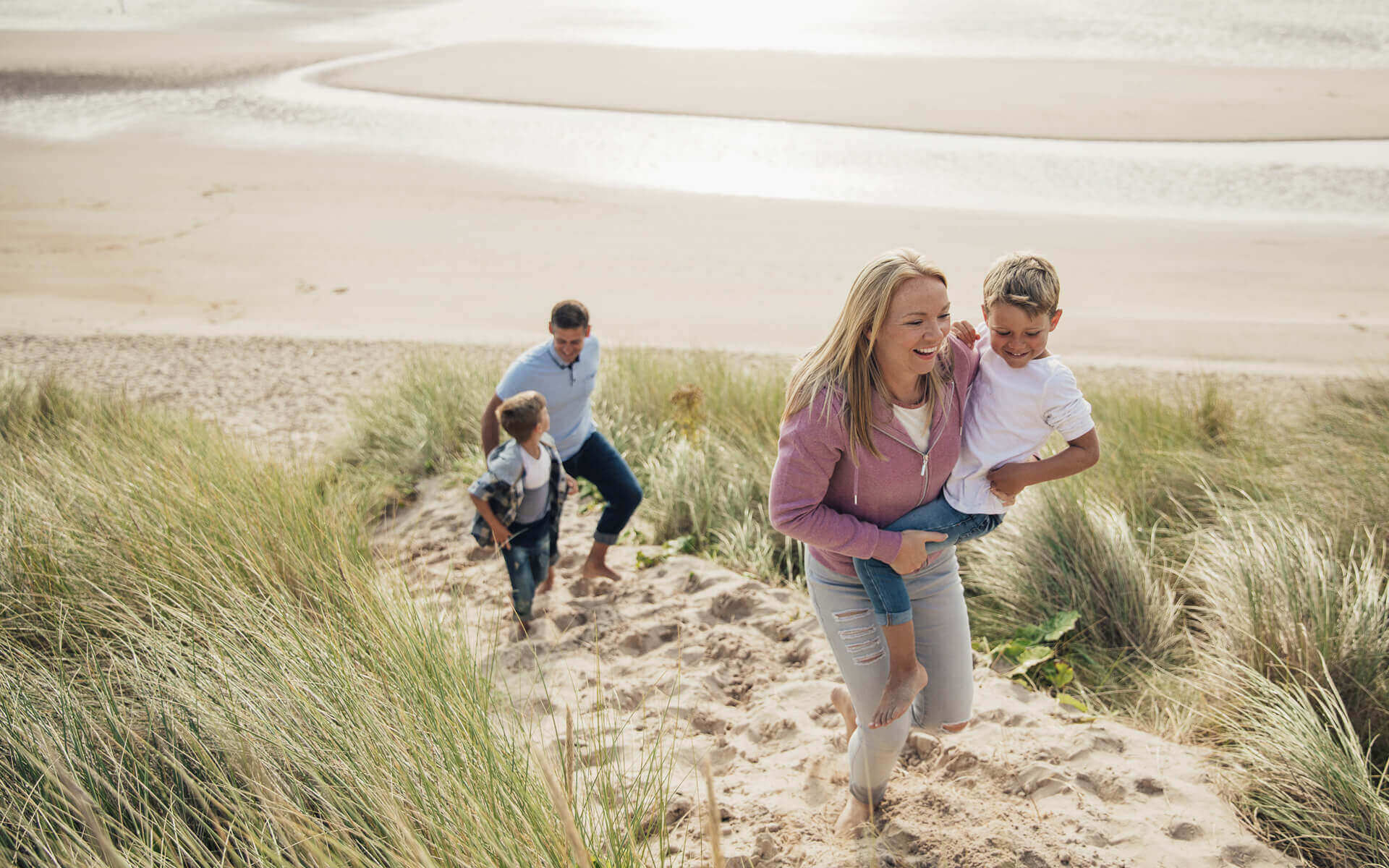 A family walking in the Bamburgh dunes