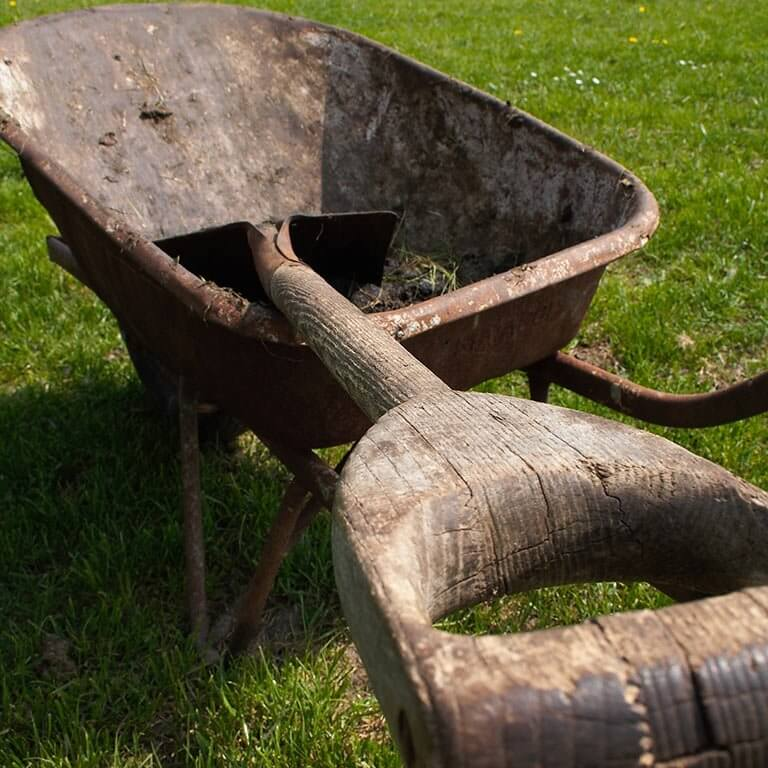 Spade in wheelbarrow on grass